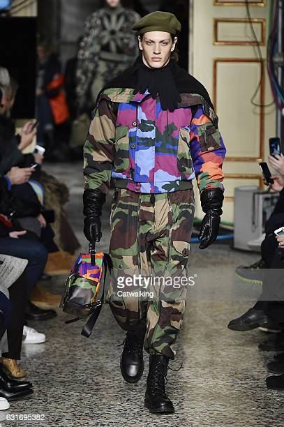 Gabriel Sihnel walks the runway at the Moschino Autumn Winter 2017 fashion show during Milan Menswear Fashion Week on January 14 2017 in Milan Italy