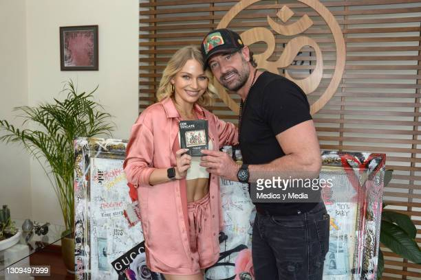 Gabriel Soto and Irina Baeva pposes for the photo with the certificate of authenticity of the work on March 27, 2021 in Mexico City, Mexico.