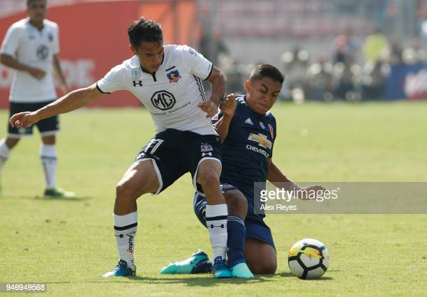 Gabriel Suazo of Colo Colo fights for the ball with Nicolas Guerra of U de Chileduring a match between U de Chile and Colo Colo as part of Torneo...
