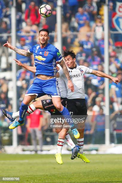 Gabriel Suazo of ColoColo struggles for the ball with Mauricio Pinilla of U de Chile during a match between ColoColo and Universidad de Chile as part...