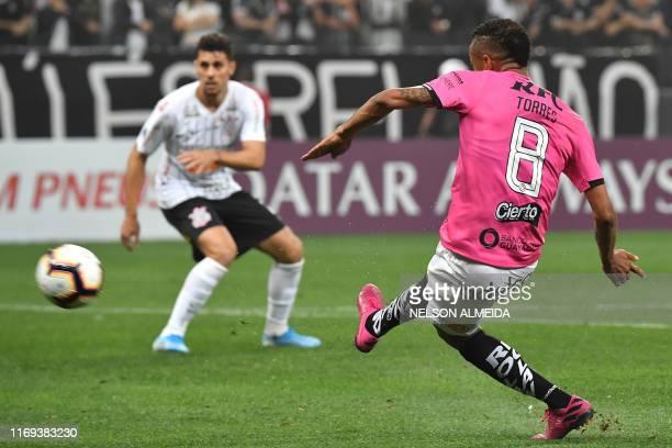 Gabriel Torres of Ecuador's Independiente del Valle kicks to score against of Brazil's Corinthians during the 2019 Copa Sudamericana first leg...
