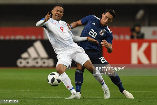 Gabriel Torres of Panama and Tomoaki Makino of Japan compete for the ball during the international friendly match between Japan and Panama at Denka...