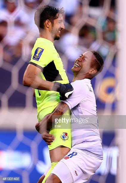 Gabriel Torres of Panama lifts teammate Jaime Penedo after they defeated Trinidad Tobago in an overtime shootout during the quarterfinals of the 2015...