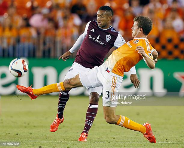 Gabriel Torres of the Colorado Rapids battles for the ball with Rob Lovejoy of Houston Dynamo during their game at BBVA Compass Stadium on March 28...