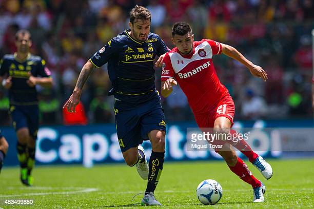 Gabriel Velasco of Toluca fights for the ball with Marco Torsiglier of Morelia during a 3rd round match between Toluca and Morelia as part of the...