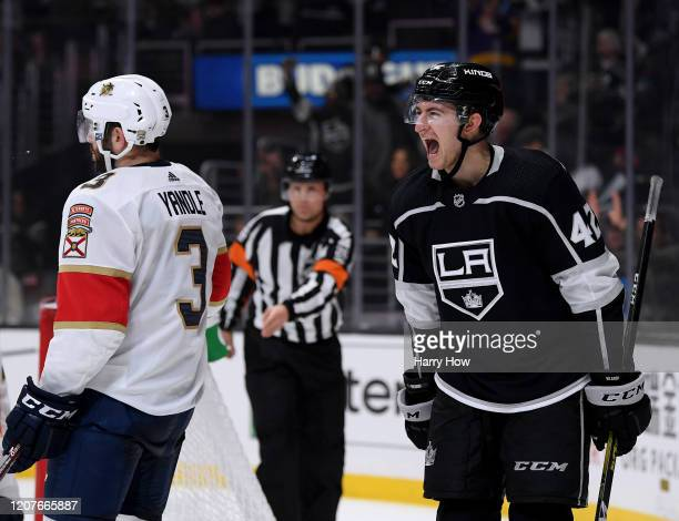 Gabriel Vilardi of the Los Angeles Kings celebrates his assist to Martin Frk, to take a 4-3 lead, behind Keith Yandle of the Florida Panthers during...