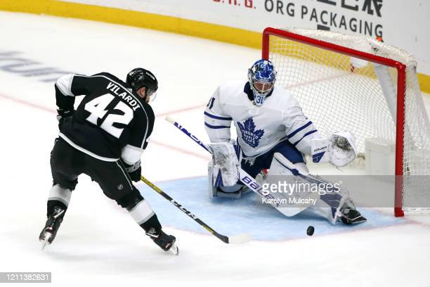 Gabriel Vilardi of the Los Angeles Kings shoots the puck against Frederik Andersen of the Toronto Maple Leafs during the second period at Staples...