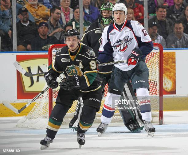 Gabriel Vilardi of the Windsor Spitfires skates between Tyler Parsons and Victor Mete of the London Knights during Game One of the OHL Western...