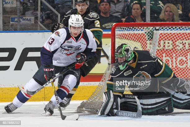 Gabriel Vilardi of the Windsor Spitfires tries a wrap around scoring attempt against Tyler Parsons of the London Knights during Game One of the OHL...