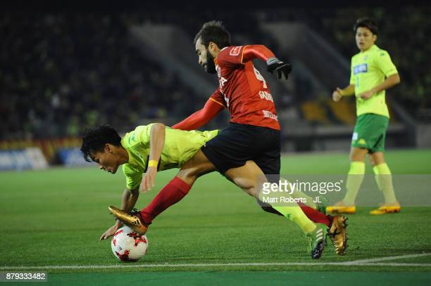 Gabriel Xavier of Nagoya Grampus and Yushi Mizobuchi of JEF United Chiba compete for the ball during the JLeague J1 Promotion PlayOff semi final...