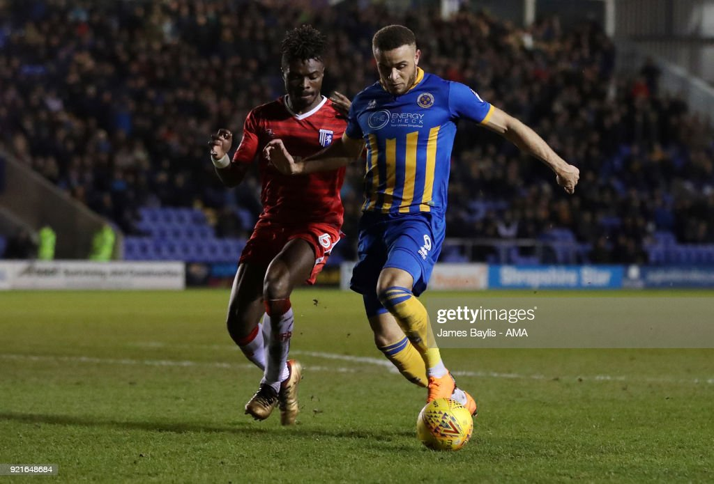 Gabriel Zakuani of Gillingham and Carlton Morris of Shrewsbury Town during the Sky Bet League One match between Shrewsbury Town and Gillingham at New Meadow on February 20, 2018 in Shrewsbury, England.