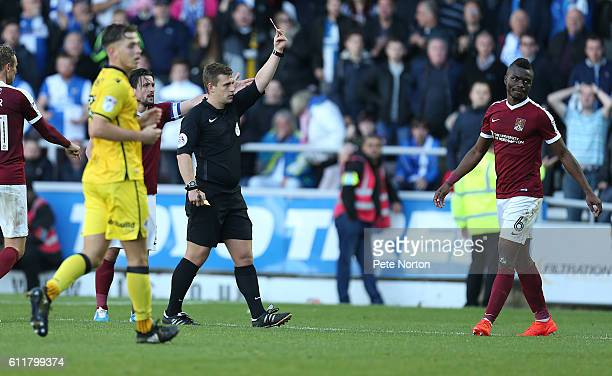 Gabriel Zakuani of Northampton Town is shown a red card by referee Josh Smith during the Sky Bet League One match between Northampton Town and...