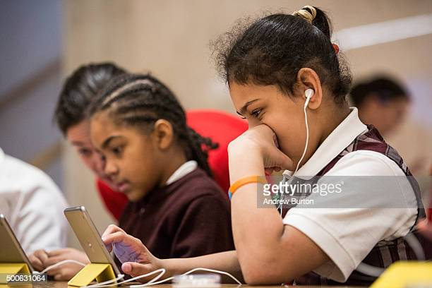 Gabriela Acevedo a third grade student from PS 57 James Weldon Johnson Leadership Academy learns how to code at an Apple Store through Apple's Hour...