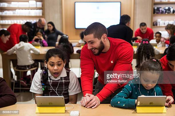 Gabriela Acevedo and Anaya Jefferson third grade students from PS 57 James Weldon Johnson Leadership Academy learn how to code at an Apple Store...