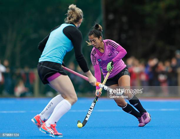 Gabriela Aguirre of Argentina fights for the ball with Charlotte Harrison of New Zealand during an International Friendly match between Argentina and...