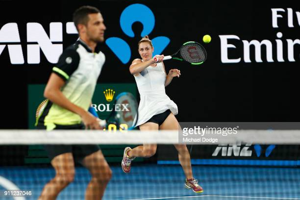Gabriela Dabrowski of Canada and Mate Pavic of Croatia celebrate winning a point in the mixed doubles final against Rohan Bopanna of India and Timea...