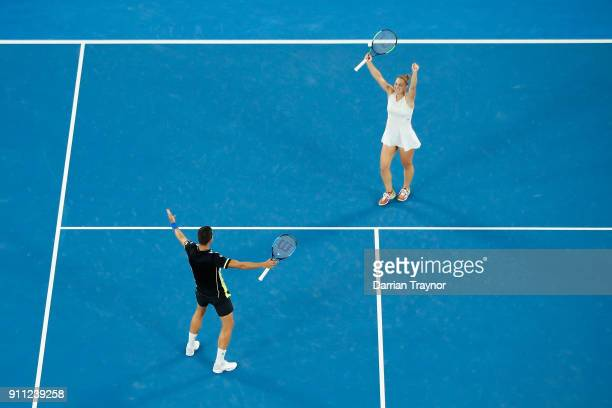 Gabriela Dabrowski of Canada and Mate Pavic of Croatia celebrate winning match point in the mixed doubles final against Rohan Bopanna of India and...
