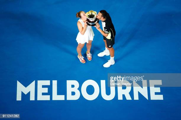 Gabriela Dabrowski of Canada and Mate Pavic of Croatia pose for a photo with the championship trophy after winning the mixed doubles final against...