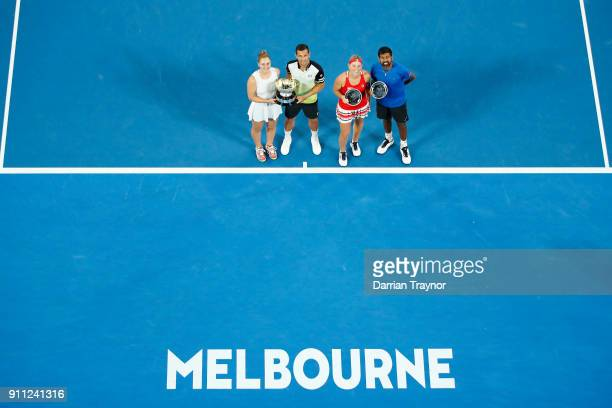 Gabriela Dabrowski of Canada and Mate Pavic of Croatia pose for a photo with the championship trophy after winning the mixed doubles final Timea...