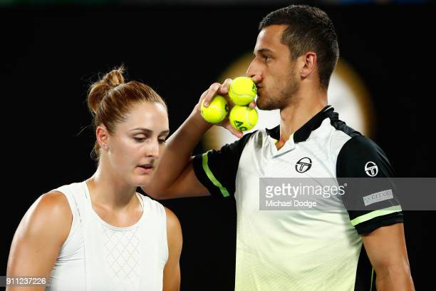 Gabriela Dabrowski of Canada and Mate Pavic of Croatia talk tactics in the mixed doubles final against Rohan Bopanna of India and Timea Babos of...