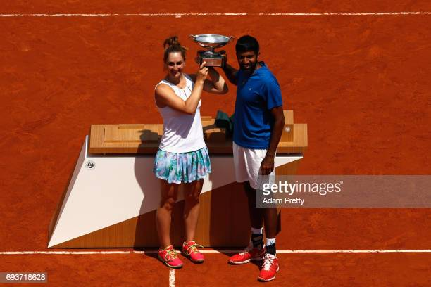 Gabriela Dabrowski of Canada and Rohan Bopanna of India celebrate with the trophy following victory in the mixed doubles final against AnnaLena...