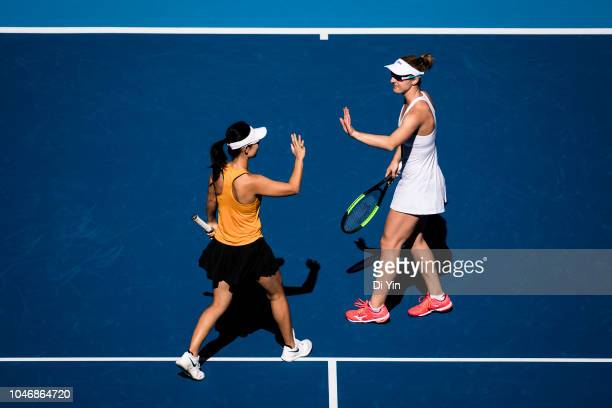 Gabriela Dabrowski of Canada and Xu Yifan of China celebrates with each other against Andrea Sestini Hlavackova and Barbora Strycova of Czech...