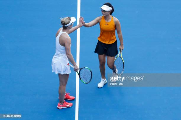 Gabriela Dabrowski of Canada and Xu Yifan of China react against Andrea Sestini Hlavackova and Barbora Strycova of Czech Republic during their...