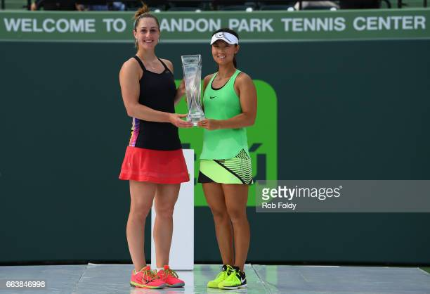 Gabriela Dabrowski of Canada and Yifan Xu of Canada pose with their trophy following the women's doubles finals on day 14 of the Miami Open at...
