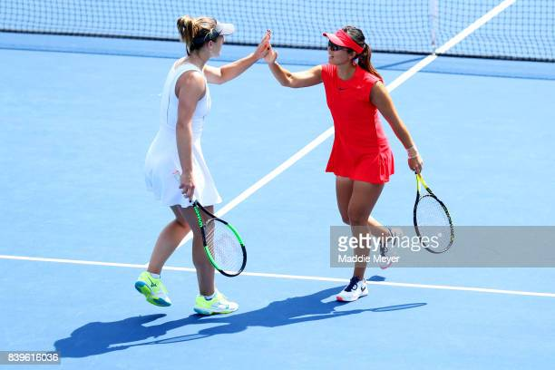 Gabriela Dabrowski of Canada and Yifan Xu of China celebrate during their match against Ashleigh Barty and Casey Dellacqua of Australia during Day 9...