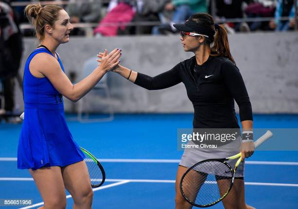 Gabriela Dabrowski of Canada and Yifan Xu of China check hands during their Women's Double First round match against Nadiia Kichenok of Ukraine and...