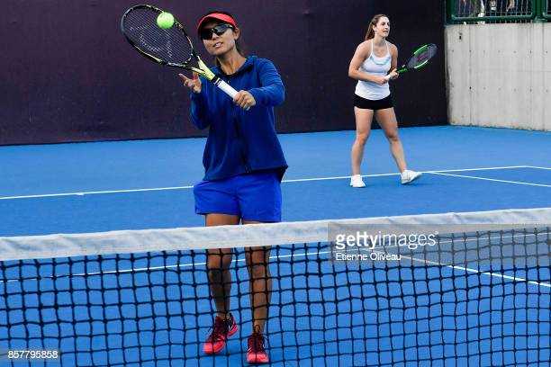 Gabriela Dabrowski of Canada and Yifan Xu of China play tennis with kids during the Inclub Clinic on day six of the 2017 China Open at the China...