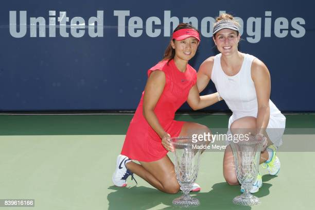 Gabriela Dabrowski of Canada and Yifan Xu of China pose with their trophies after defeating Ashleigh Barty and Casey Dellacqua of Australia during...