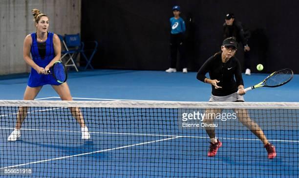 Gabriela Dabrowski of Canada and Yifan Xu of China return a shot against Nadiia Kichenok of Ukraine and Anastasia Rodionova of Australia during their...