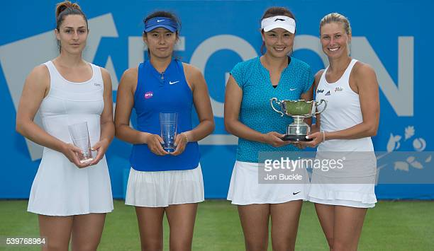 Gabriela Dabrowski of Canada and Zhaoxuan Yang of China pose with runner's up trophy alongside Shuai Peng of China and Andrea Hlavackova of Czech...