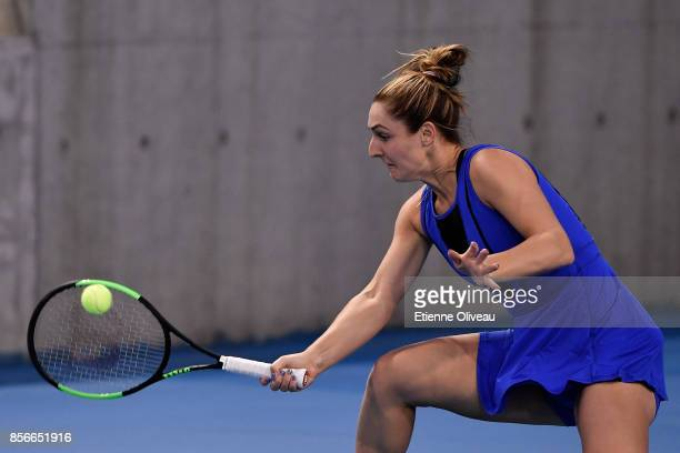 Gabriela Dabrowski of Canada returns a shot in a match in partnership with Yifan Xu of China against Nadiia Kichenok of Ukraine and Anastasia...