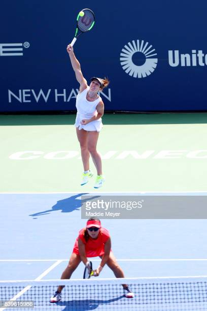 Gabriela Dabrowski of Canada serves over Yifan Xu of China during their match against Ashleigh Barty and Casey Dellacqua of Australia during Day 9 of...