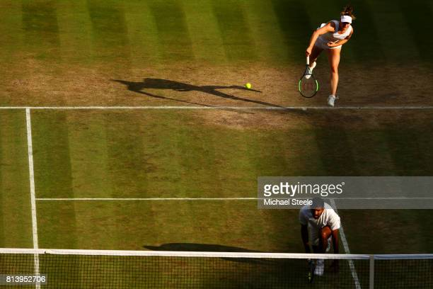Gabriela Dabrowski of Canada serves partnering Rohan Bopanna of India in the Mixed Doubles quarter final match against Heather Watson of Great...