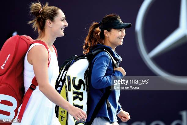 Gabriela Dabrowski of Cananda and Yifan Xu of China come to the court before their doubles match against Raluca Olaru of Romania and Lyudmyla...