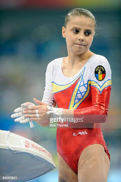 Gabriela Dragoi of Romania chalking her hands during qualification for the women's artistic gymnastics event held at the National Indoor Stadium...