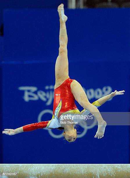 Gabriela Dragoi of Romania performs on the balance beam during qualification for the women's artistic gymnastics event held at the National Indoor...