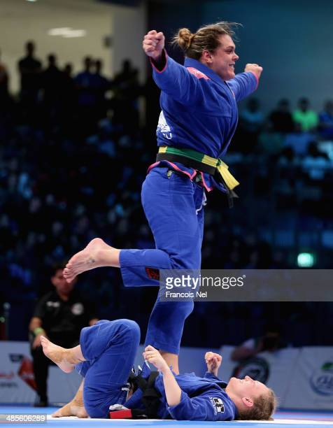 Gabriela Garcia of Brazil celebrates after winning against Janni Larsson of United States in the Women's brown black belt open weight finals during...