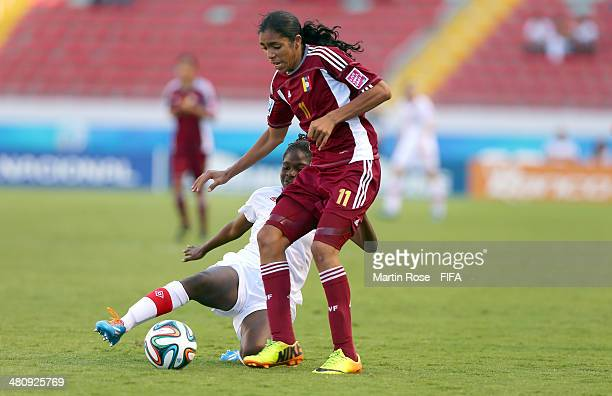 Gabriela Garcia of Venezuela and Easther Mayi Kith of Canada battle for the ball during the FIFA U17 Women's World Cup 2014 quarter final match...