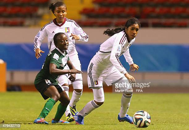 Gabriela Garcia of Venezuela and Margaret Belemu of Zambia battle for the ball during the FIFA U17 Women's World Cup 2014 group A match between...
