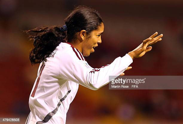 Gabriela Garcia of Venezuela celebrates after scoring the 3rd goal during the FIFA U17 Women's World Cup 2014 group A match between Venezuela and...