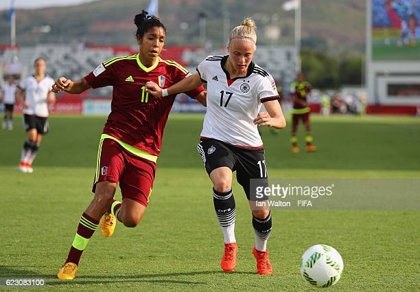 Gabriela Garcia of Venezuela tries to tackle Pia-Sophie Wolter of Germany during the FIFA U-20 Women's World Cup, Group D match between Germany and...