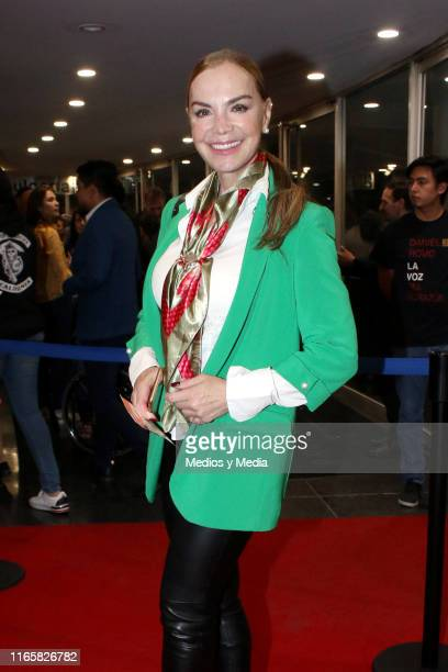 Gabriela Goldsmith poses for photos on the red carpet during a new premiere of the play 'Suertudotas' after changing the venue to Teatro Insurgentes...