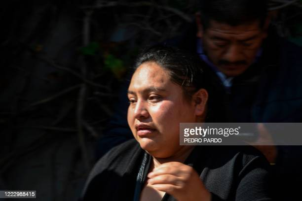 Gabriela Gomez, sister of Rosa Gomez -a passerby killed-, mourns after arriving at the crime scene where Mexico City's Public Security Secretary Omar...