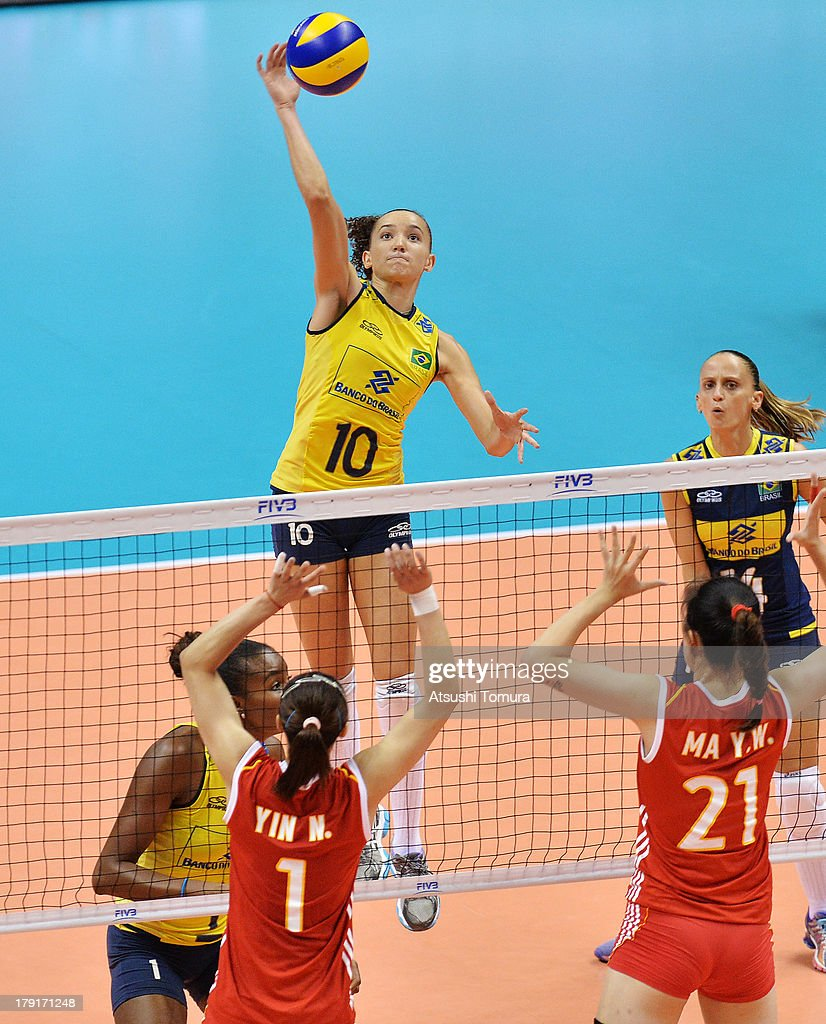 Gabriela Guimaraes of Brazil spikes the ball during day five of the FIVB World Grand Prix Sapporo 2013 match between China and Brazil at Hokkaido Prefectural Sports Center on September 1, 2013 in Sapporo, Hokkaido, Japan.