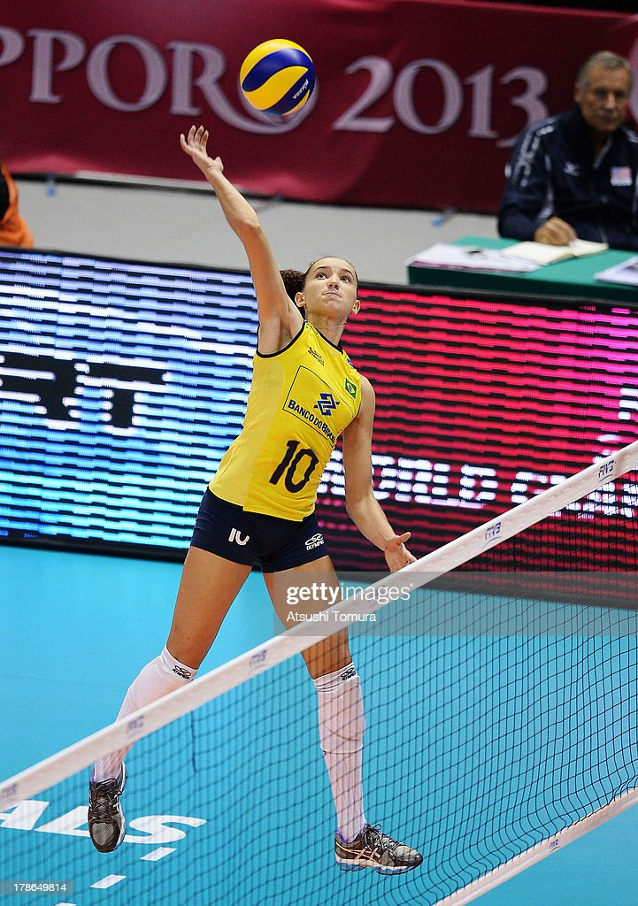Gabriela Guimaraes of Brazil spikes the ball during day three of the FIVB World Grand Prix Sapporo 2013 match between Brazil and Italy at Hokkaido Prefectural Sports Center on August 30, 2013 in Sapporo, Hokkaido, Japan.