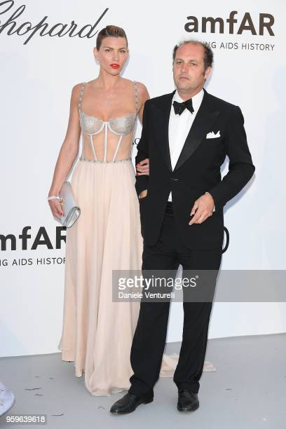 Gabriela Iliescu and Francesco Melzi D'Eril arrive at the amfAR Gala Cannes 2018 at Hotel du CapEdenRoc on May 17 2018 in Cap d'Antibes France